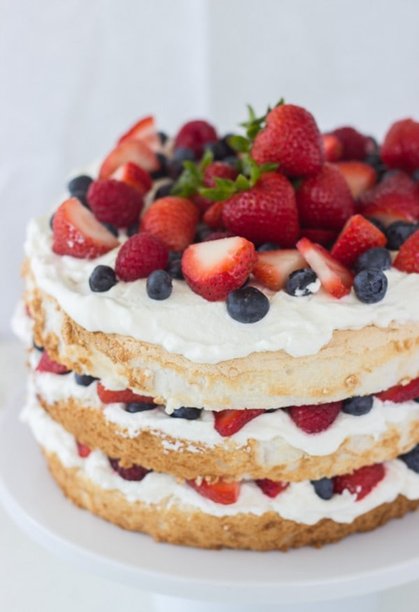 Angel food cake with coconut whipped cream and berries a classic twist this classic angel food cake recipe is filled with homemade dairy free coconut whipped cream forumfinder Gallery