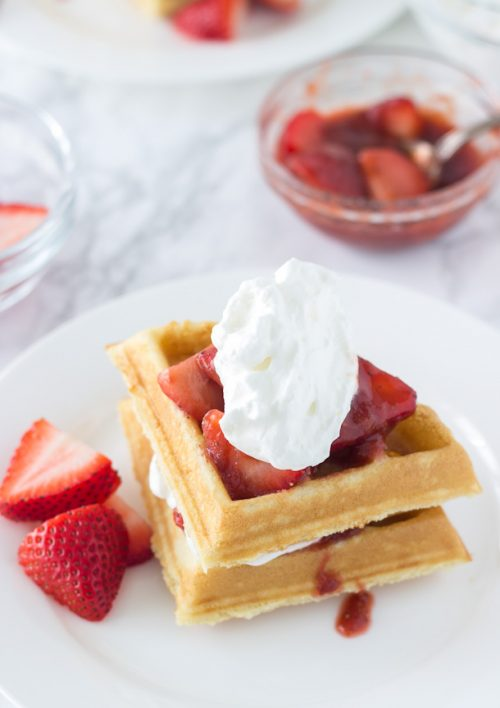 This Easy Coconut Waffles recipe made with a buttermilk pancake mix and topped with strawberry rhubarb compote. Perfect for brunch.