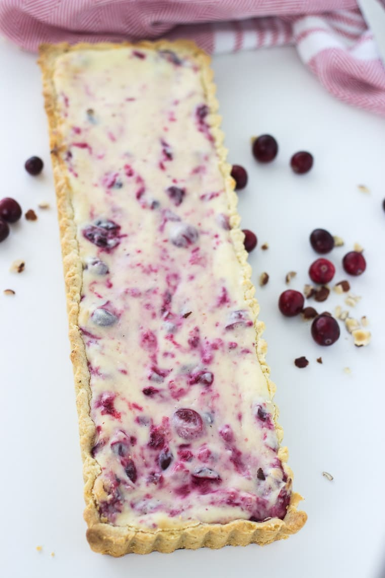 This simple cranberry hazelnut cream cheese tart chewy, with a nutty crust and tart, sweet cream cheese filling that complement each other.
