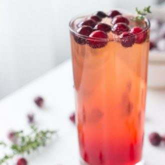 Refreshing Cranberry Thyme Sparklers made bubbly with 7UP or Ginger Ale make for a simple and easy holiday cocktail.