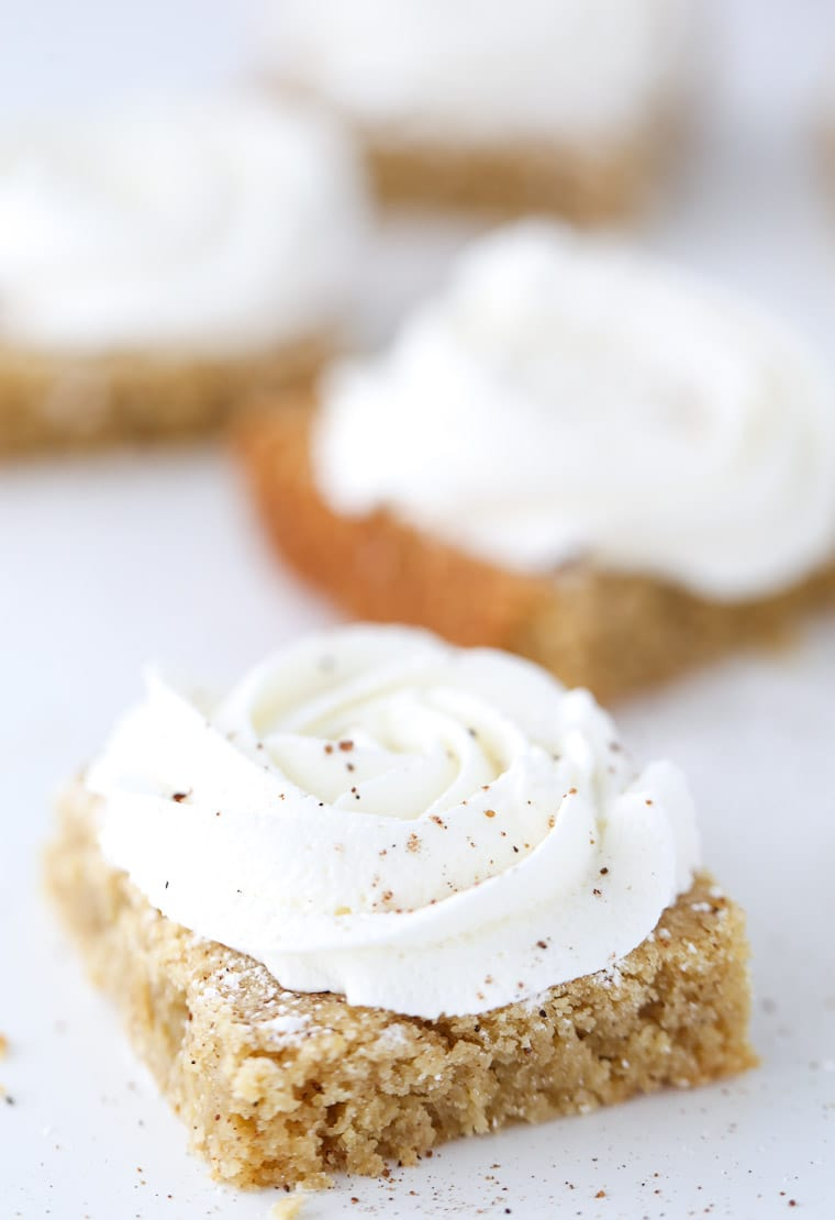 Ooey gooey eggnog cookie bars with brown butter in the batter and a sweet rum buttercream
