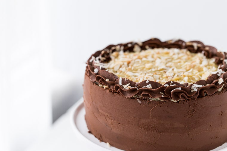 This classic German Chocolate Cake is a rich chocolate cake, filled with a coconut pecan filling and finished off with a decadent chocolate frosting.