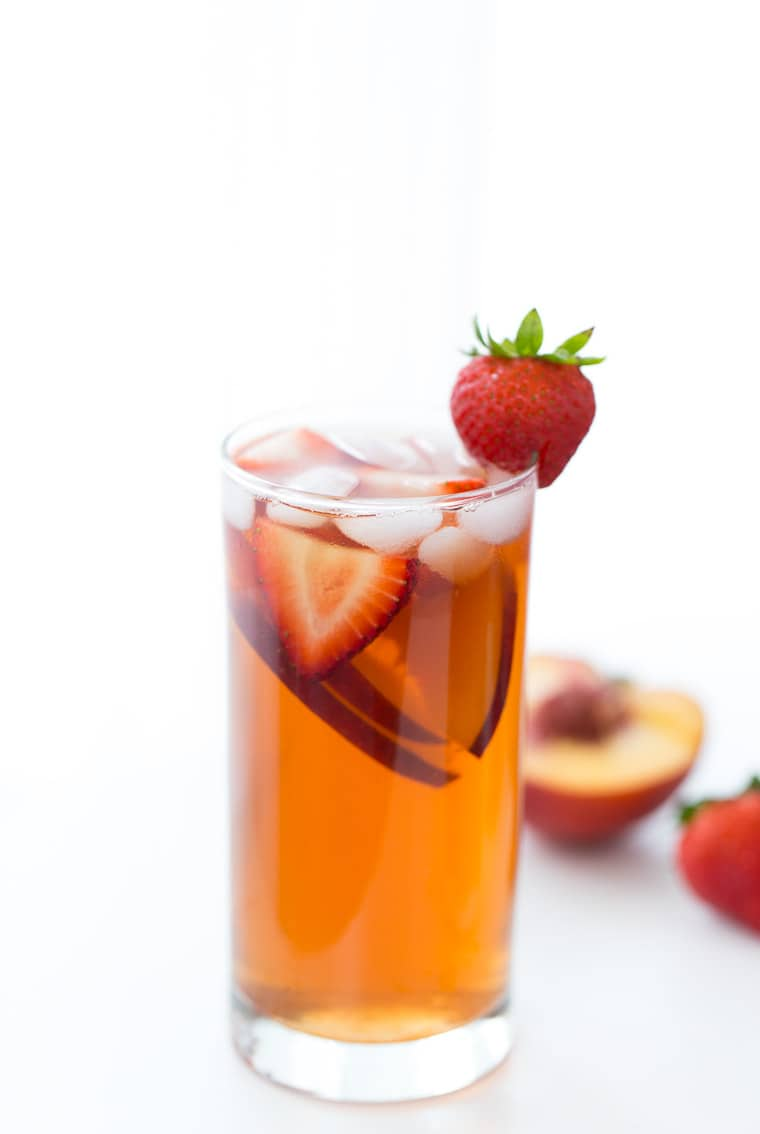 This homemade Strawberry Peach Iced Tea recipe is refreshing, sweet and bursting with fresh peaches and strawberry flavor.