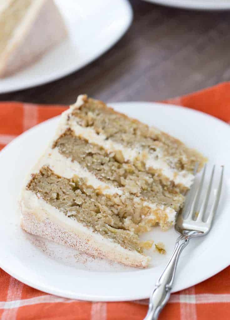 A soft, moist and crumbly apple cider cake with a whipped vanilla malt frosting makes this cake a great fall recipe.