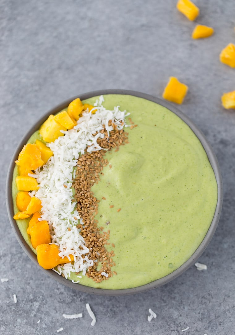 This green mango coconut smoothie bowl is packed with good-for-you ingredients and tropical flavors.