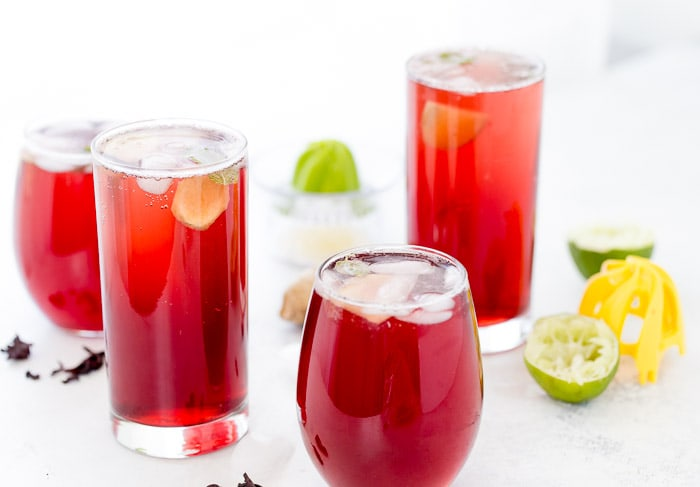 This refreshing Hibiscus Sparkler with hints of ginger and fresh lime juice is easy to whip up and perfect for brunch and summer parties.