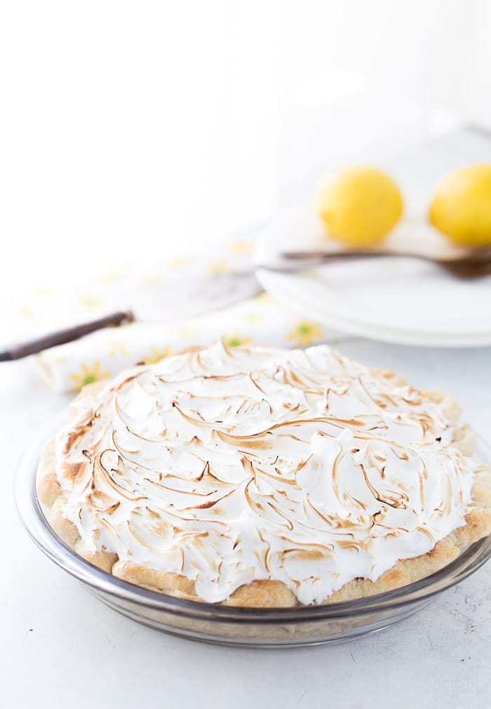 This classic lemon meringue pie is beyond amazing with a flaky pie crust filled with tart lemon custard filling and topped with a toasty meringue cloud.