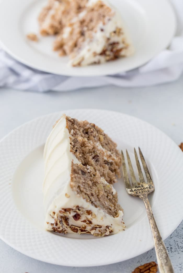 A classic hummingbird cake with a pineapple, banana and pecan spiced cake topped with cream cheese frosting.