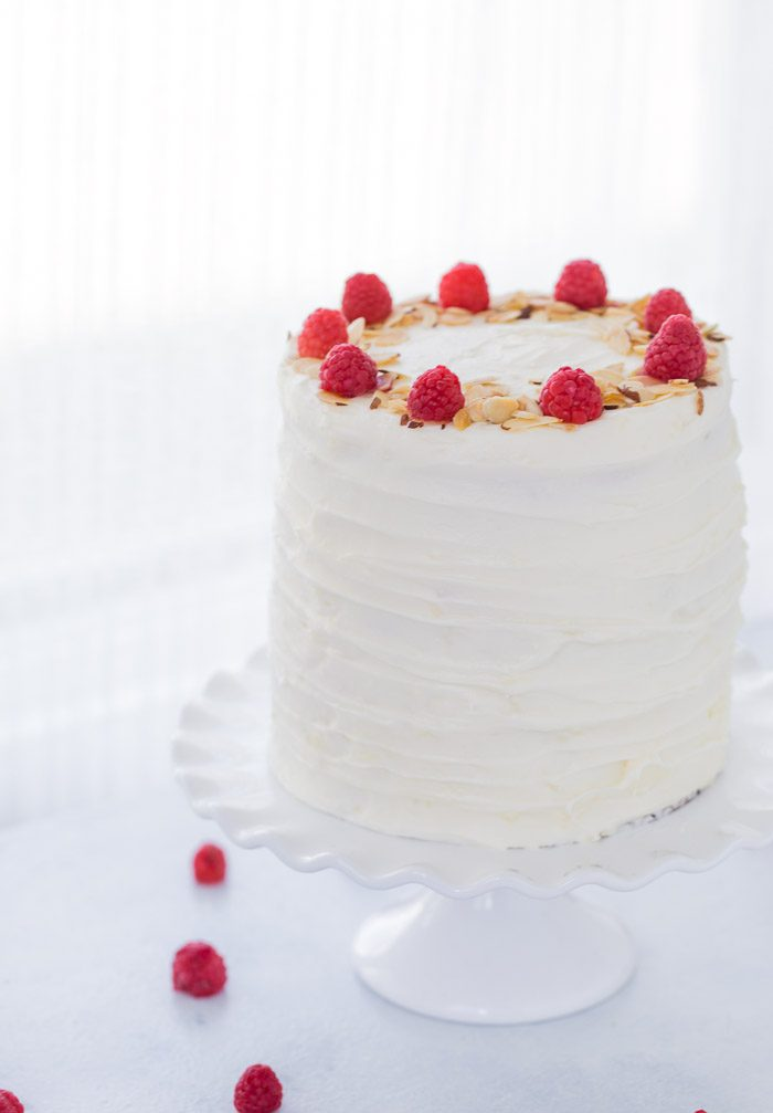 A luscious lemon raspberry cake recipe that is filled with a whipped honey mascarpone filling, raspberry compote and sweet cream cheese frosting.