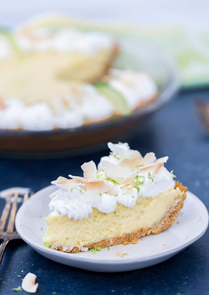 This coconut key lime pie brings sweet tropical flavors to your classic key lime pie recipe. With a chewy, crunchy coconut graham cracker crust, the filling is tart, creamy and delicious. Perfect for spring and summer.  #keylime #pie #sweets #dessert #easter