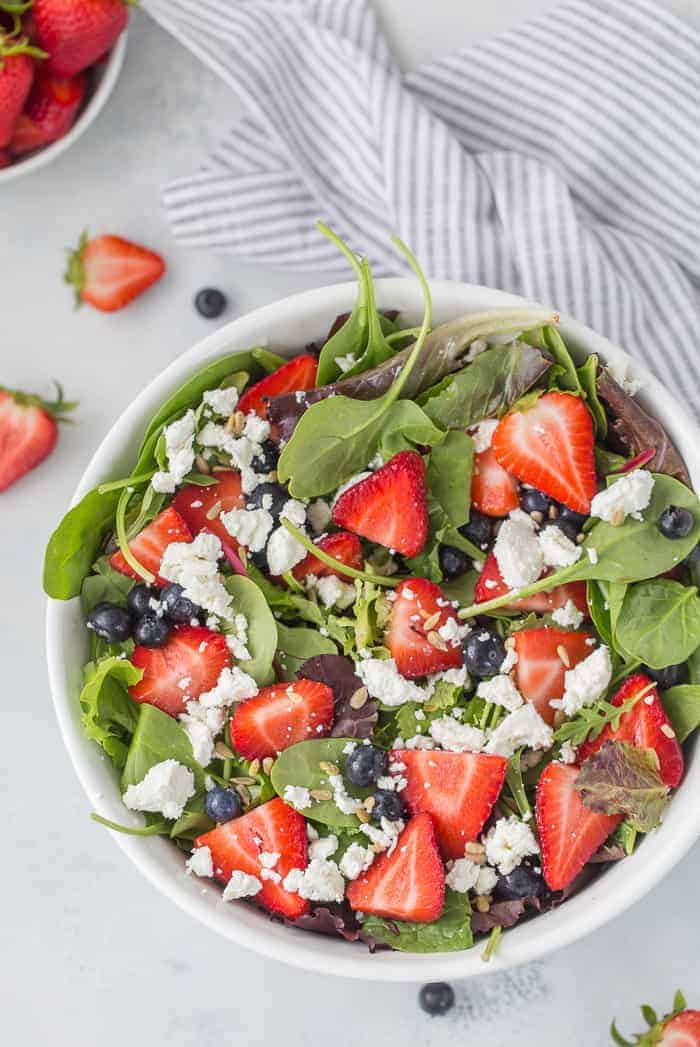 Fresh summer berries are tossed withgoat cheese and balsamic vinegar in this perfectly balanced sweet and salty mixed berry salad.#salad #summersalad #summer #recipe #mixedberrysalad