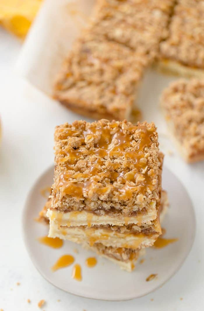 A triple layer of apples, cheesecake and crumb coat make these apple crumble cheesecake bars a different take on a classic fall dessert.